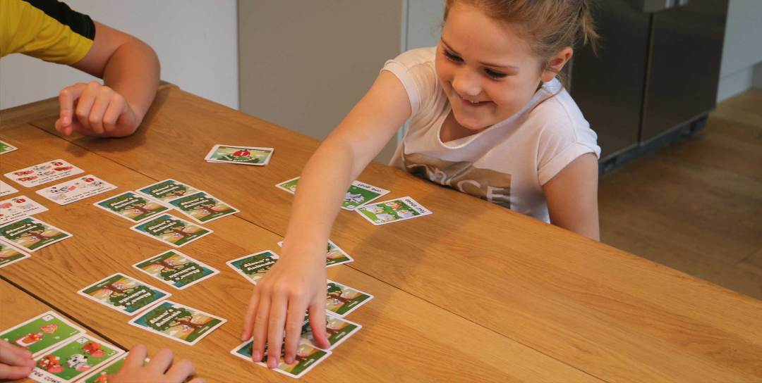 Children having fun while playing Alana's animals