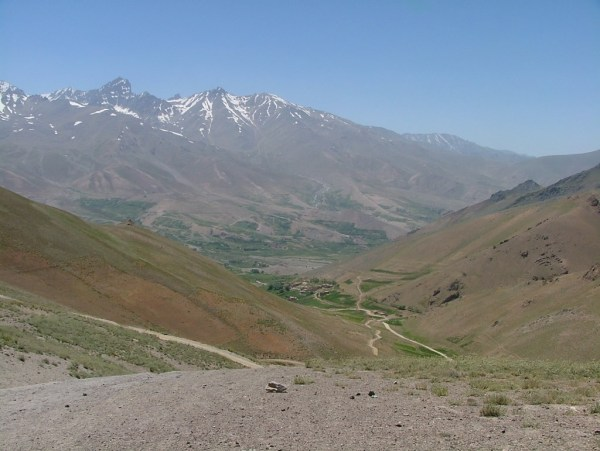 Typical Afghan landscape with the tortuous road leading to a village in the valley