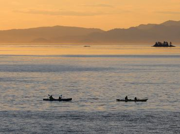 Alaska Sea Kayakers on Scenic Sunset Trip