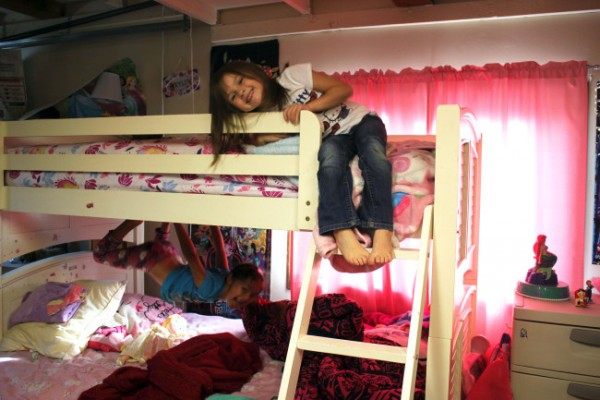 The Lohreys converted the garage into a bedroom that Kristyanna, 6, and Kylie, 5, share. (Photo by Lisa Phu/KTOO)