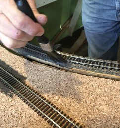 tom begins painting track and cork using a 50 50 mix of water and camouflage colored paint eventually ballast will be laid and if coverage is not perfect  [ 1600 x 1200 Pixel ]