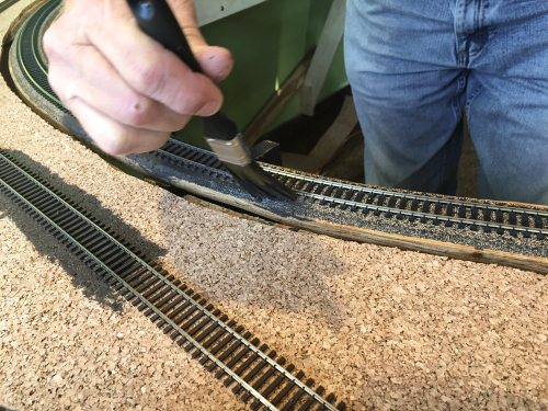 small resolution of tom begins painting track and cork using a 50 50 mix of water and camouflage colored paint eventually ballast will be laid and if coverage is not perfect