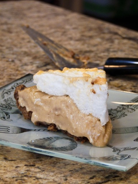 This peanut butter surprise pie has a honey graham cracker test, peanut butter custard in the center, and a toasted meringue topping! This peanut butter custard pie is rich, delicious, and incredibly easy to make!