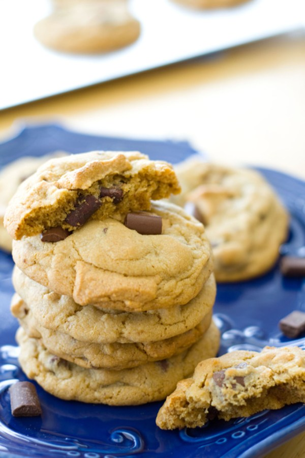 These amazingly decadent cookies are thick, chewy, and studded with peanut butter fudge! They're pretty much life changing.