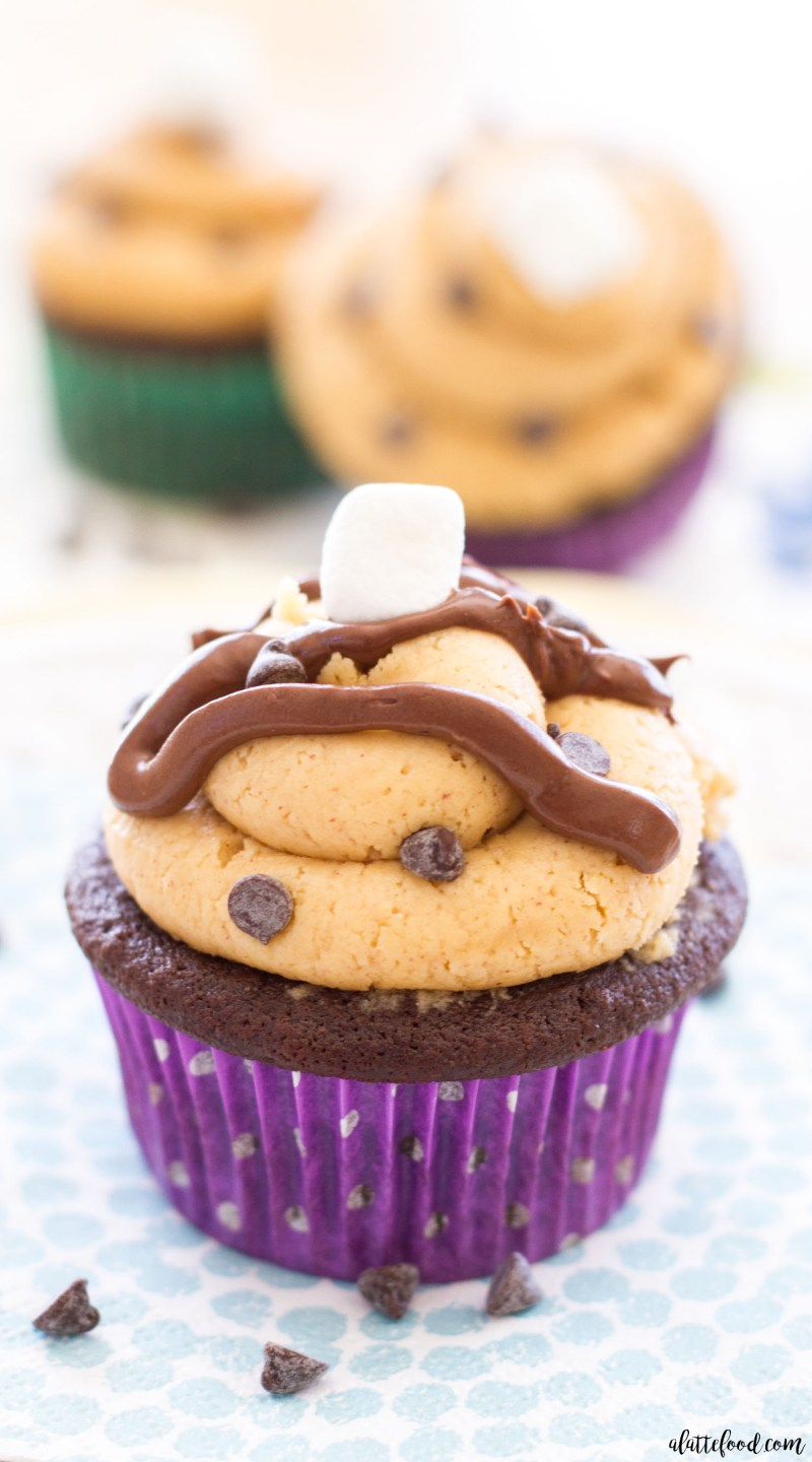 These Chocolate Fluffernutter Cupcakes begin with a milk chocolate cupcake base, are stuffed with marshmallows, and are topped with sweet homemade peanut butter frosting! The choc-o-holic's must have dessert!