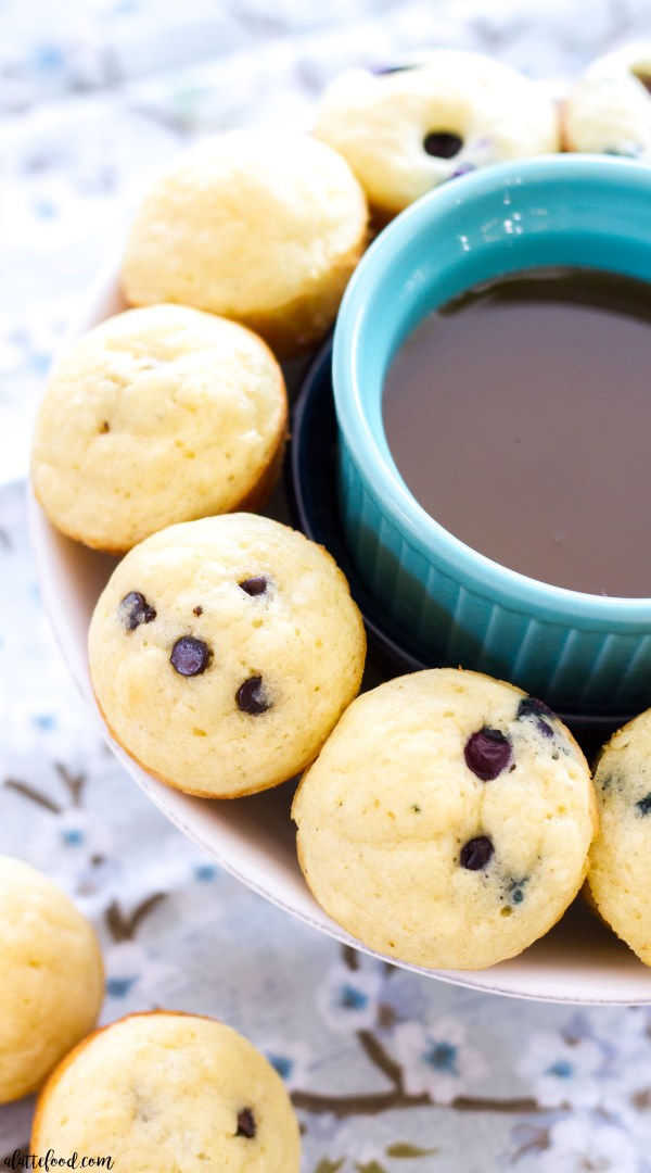 These easy homemade Pancake Mini Muffins are the perfect on-the-go breakfast recipe! They have a basic pancake base, and can be filled with blueberries, chocolate chips, and anything else you desire!