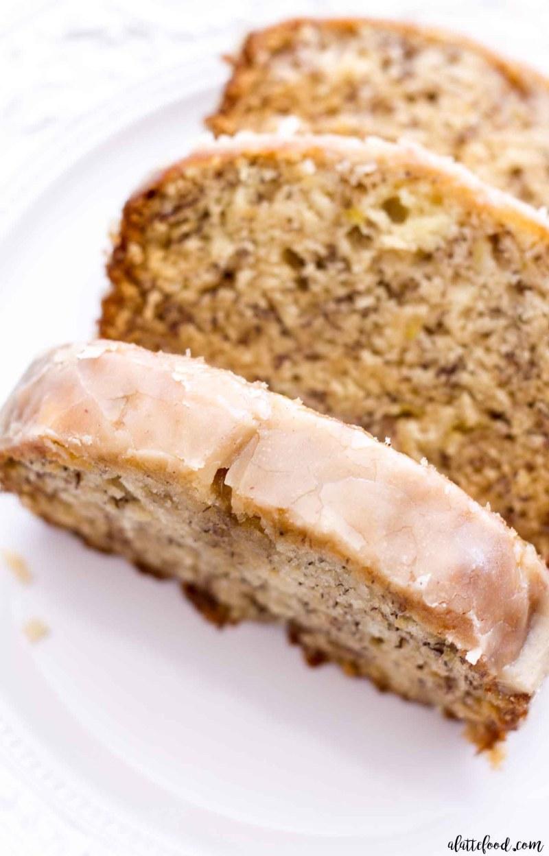 glazed banana bread slice on white plate