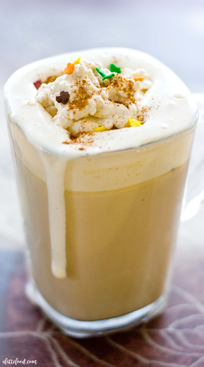 Pumpkin Spice Latte with Pumpkin Whipped Cream: This homemade pumpkin spice latte tastes just like a coffee shop version! Plus it's topped with homemade pumpkin whipped cream that just might be the best thing since sliced pumpkin bread.