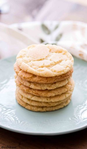 cinnamon sugar snickerdoodles stacked on a blue plate