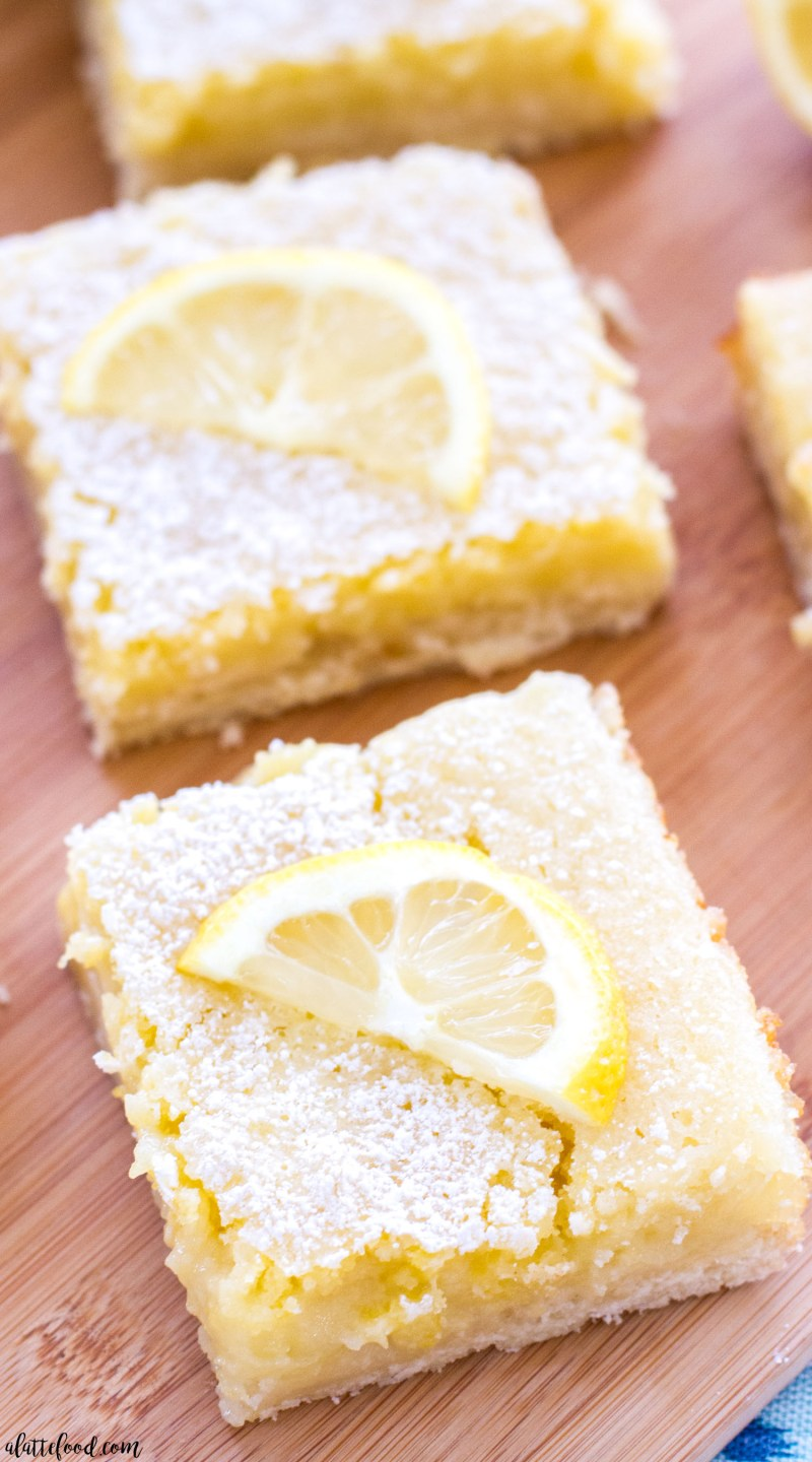 classic lemon bars cut in squares and topped with powdered sugar