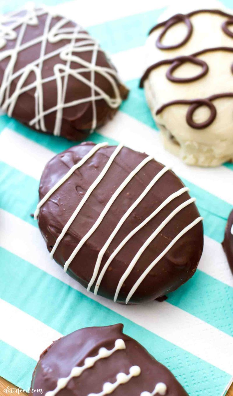 Chocolate covered cookie dough truffles shaped into easter eggs