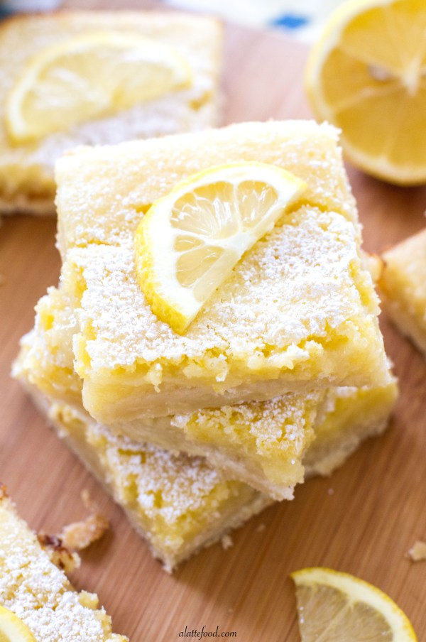 These sweet bars are filled with tangy lemon filling sitting on top of a shortbread crust! The perfect spring dessert.
