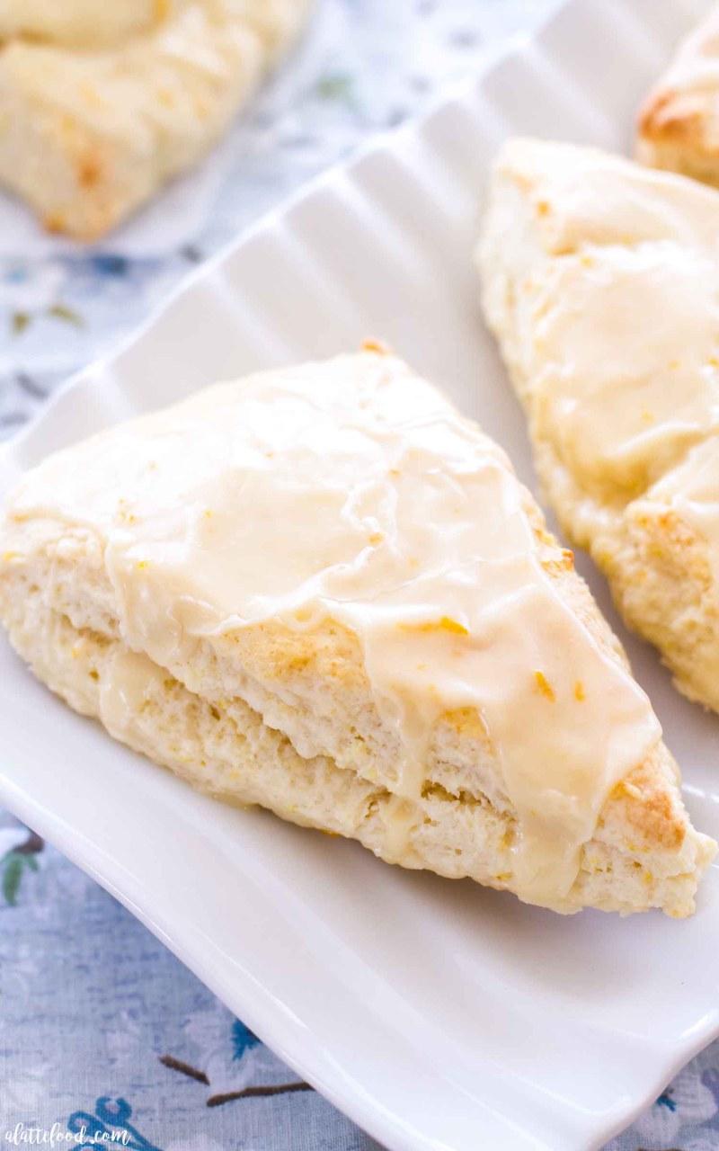 baked orange scones on white serving platter