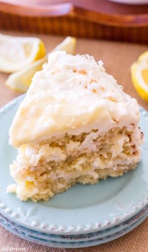 slice of coconut lemon cake on teal plates