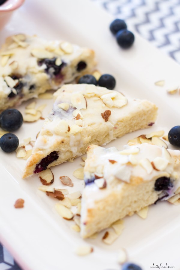 These tender scones are packed with sweet blueberries and plenty of almond flavoring! | www.alattefood.com