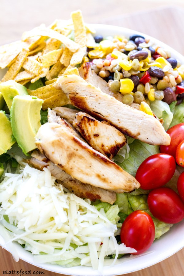 This flavorful salad is packed with the works: Tyson Grilled & Ready Chicken Fillets, Birds Eye Southwestern Protein Blend, pepper jack cheese, avocado, tortilla strips, tomatoes, and barbecue sauce. Quick, easy, and oh-so-delish!| www.alattefood.com