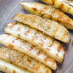 These irresistible potato wedges are seasoned with black pepper and parmesan cheese! They start off in the oven and finish off on the grill! | www.alattefood.com