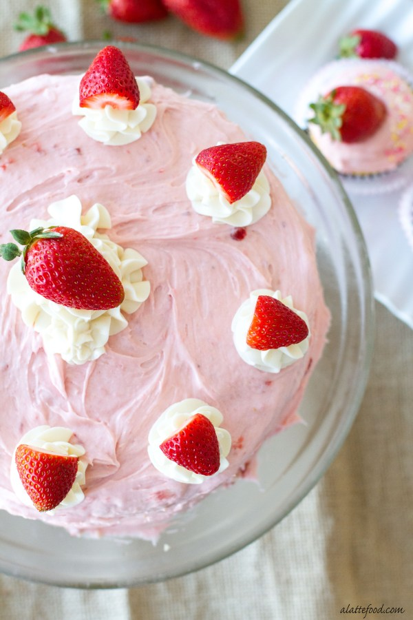 These fluffy vanilla cupcakes are light, airy, and topped with the most amazing fresh strawberry buttercream!