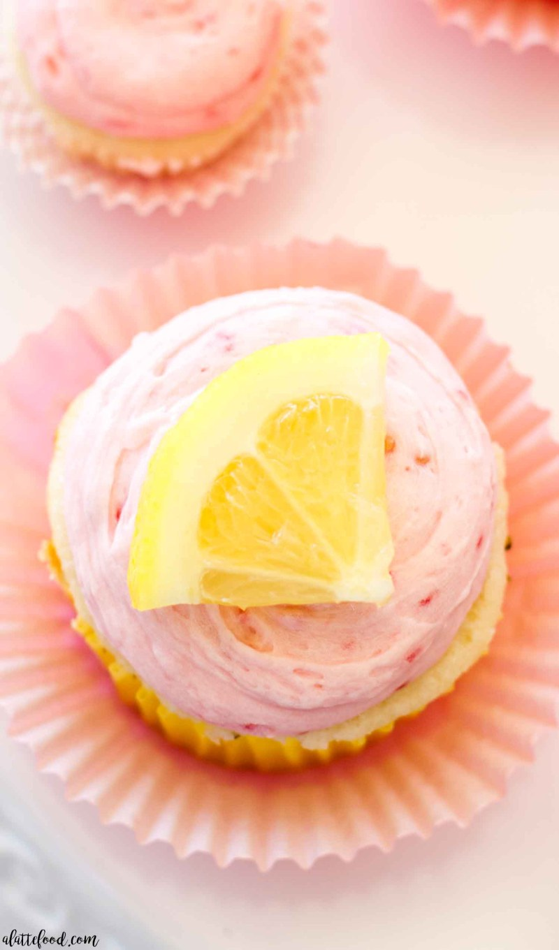 overhead shot of lemon cupcakes with raspberry buttercream