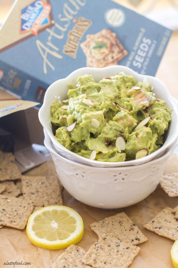 Chopped chicken gets mixed with creamy avocados, lemon juice, sour cream, pepper jack cheese, almonds, and a blend of seasonings to create the ultimate chicken salad. | www.alattefood.com