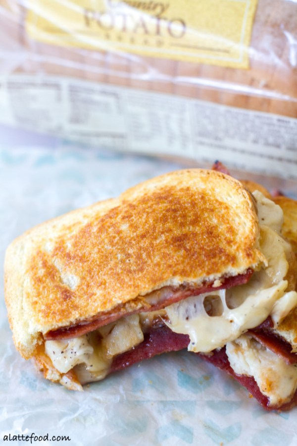Packed with the works, this grilled cheese is comfort food at its finest. Cheesy bacon goodness.   www.alattefood.com
