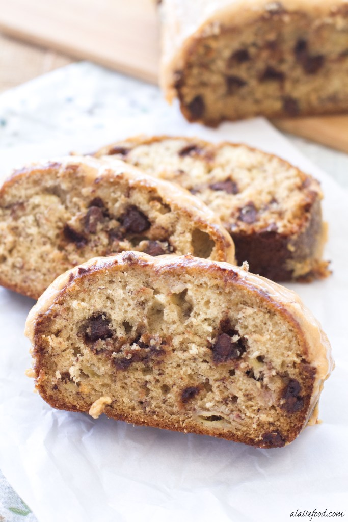 This classic banana bread is filled with sweet chocolate chips and topped with the best peanut butter icing! The peanut butter glaze and the melty chocolate chips make this Chocolate Chip Banana Bread recipe absolutely to die for! You're sure to love this quick and easy snack or dessert!