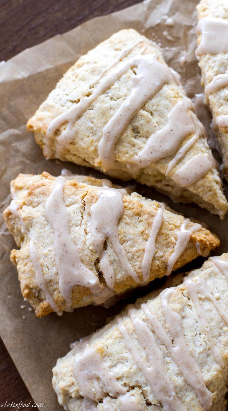 These light and flaky Maple Cream Scones are full of sweet maple flavor and topped with a cinnamon spice glaze! These Maple Cream Scones are the perfect fall breakfast, or sweet fall dessert!
