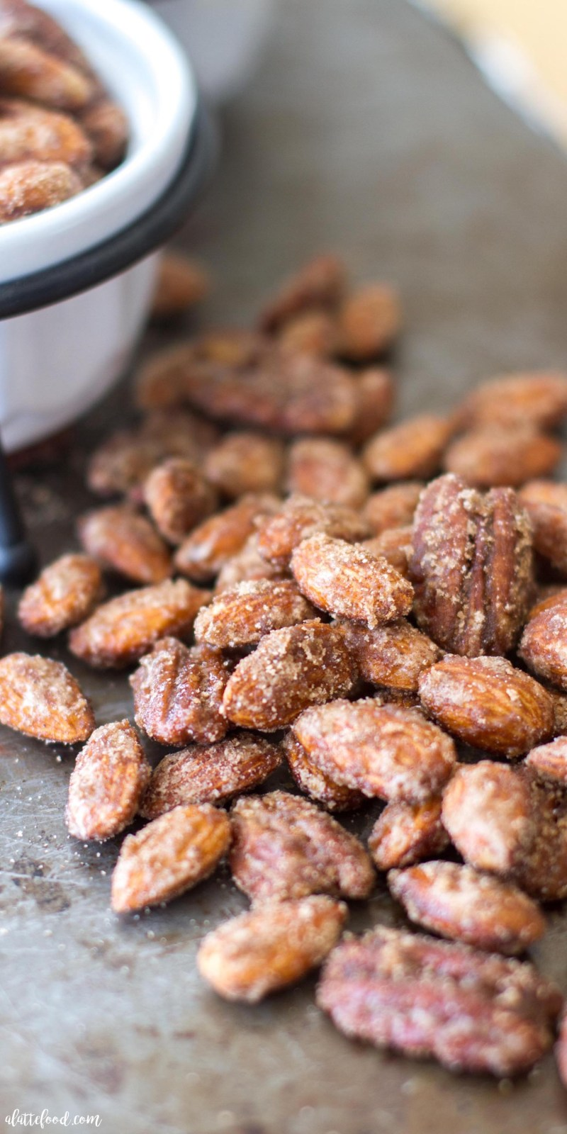 These sugared almonds and pecans are candied with a blend of pumpkin pie spice, white sugar, and brown sugar to make the most irresistible snack! Candied nuts are the ultimate fall snack, and this Pumpkin Spice Candied Nuts recipe is SO simple!