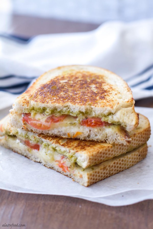 This easy grilled cheese is filled with mozzarella, pesto, and tomatoes, making it classic comfort food. All the ingredients of caprese are sandwiched between two slices of sourdough!
