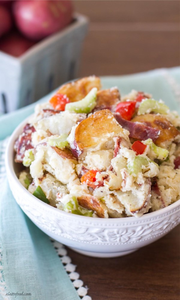 This simple potato salad recipe is full of flavor and easily customizable! With roasted red potatoes and bacon, this potato salad is irresistible!
