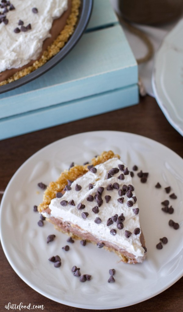 This no-bake mocha cream pie recipe is a chocolate lover's dream! Whipped cream and chocolate coffee cream sits on top of a vanilla wafer crust for a rich and creamy dessert!