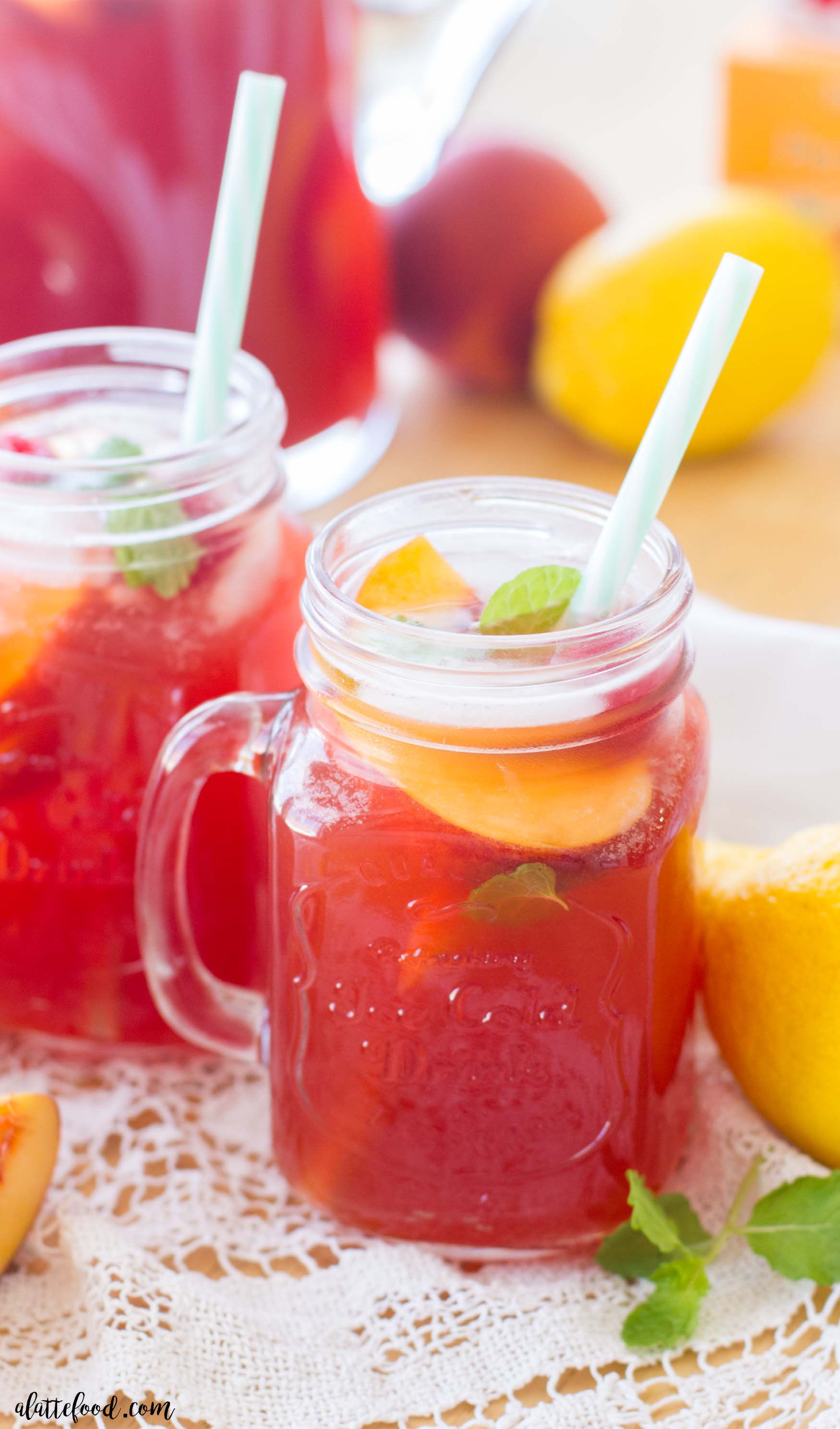 ... and This easy homemade iced tea recipe is filled with fresh peaches, sweet raspberries, and