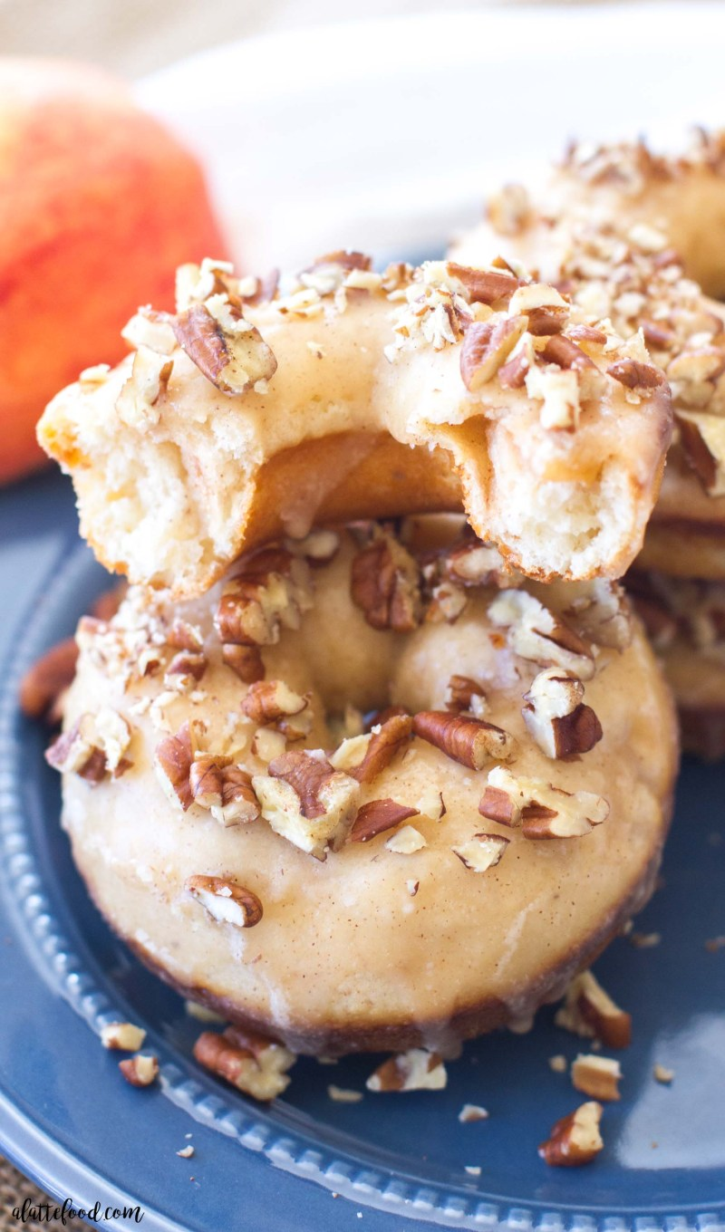 These simple baked apple donuts are filled with sweet apples and cinnamon, and topped with a maple glaze and chopped pecans!