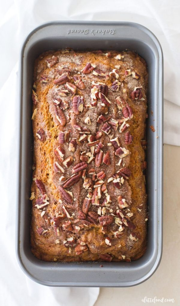 This easy pumpkin pecan banana bread recipe is my current favorite fall dessert! Sweet banana bread is mixed with pumpkin puree and topped with cinnamon sugar and crushed pecans!