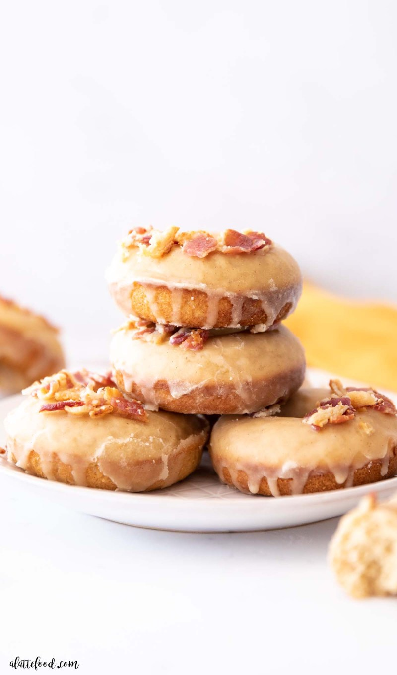 stack of maple donuts with bacon on a white marble board