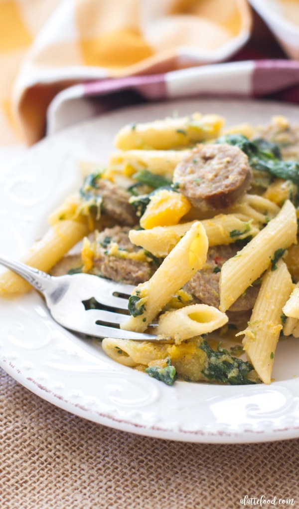 This easy fall dinner recipe is filled with mild Italian sausage, creamy butternut squash, spinach, ricotta cheese, and penne pasta to make a flavorful, inexpensive, and easy meal!