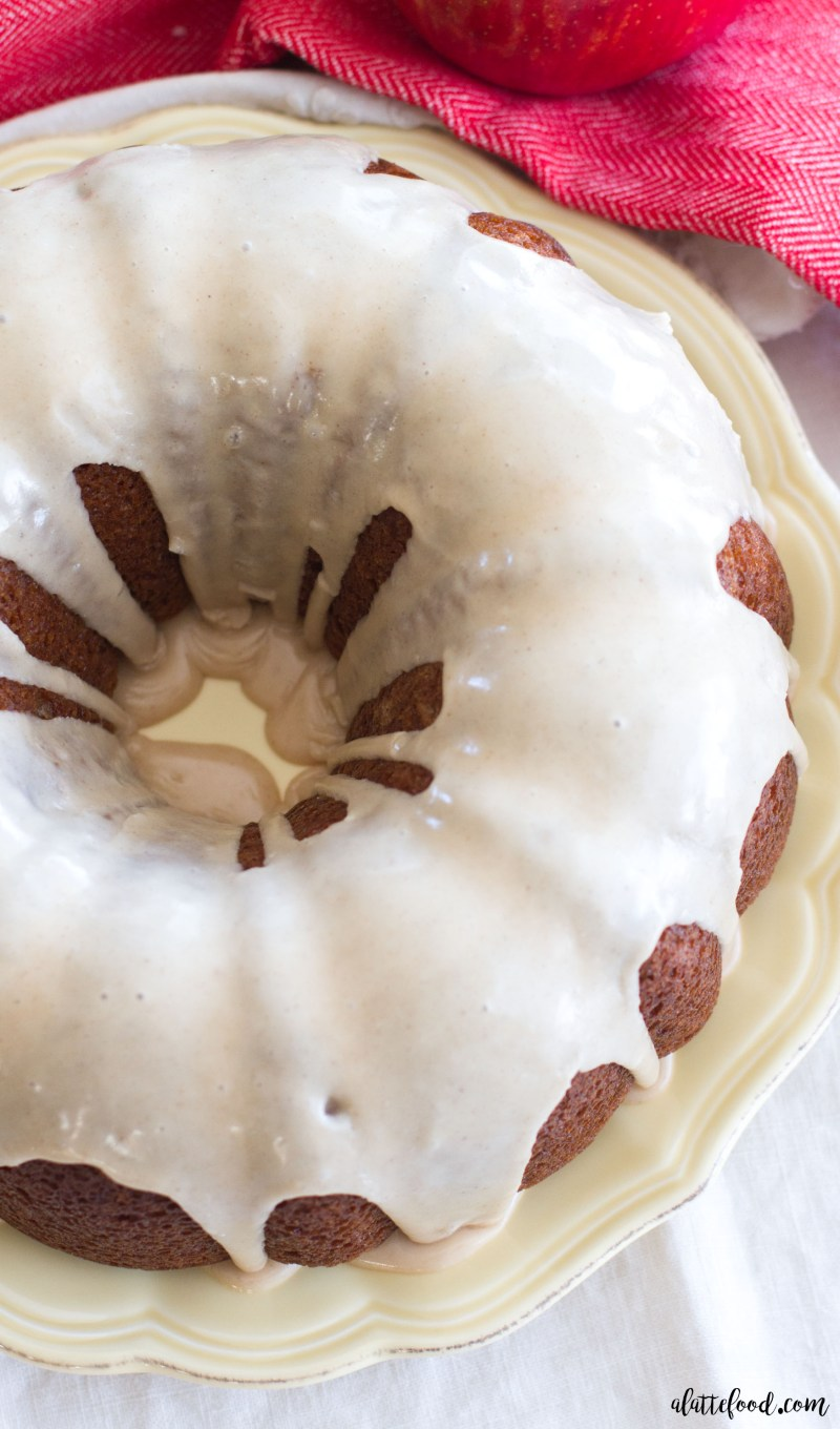 This easy apple spice bundt cake recipe is the perfect dessert! Filled with both shredded and chopped apples, this cake is full of sweet apple flavor! The vanilla glaze is the cherry-on-top, making this easy apple cake a family favorite!
