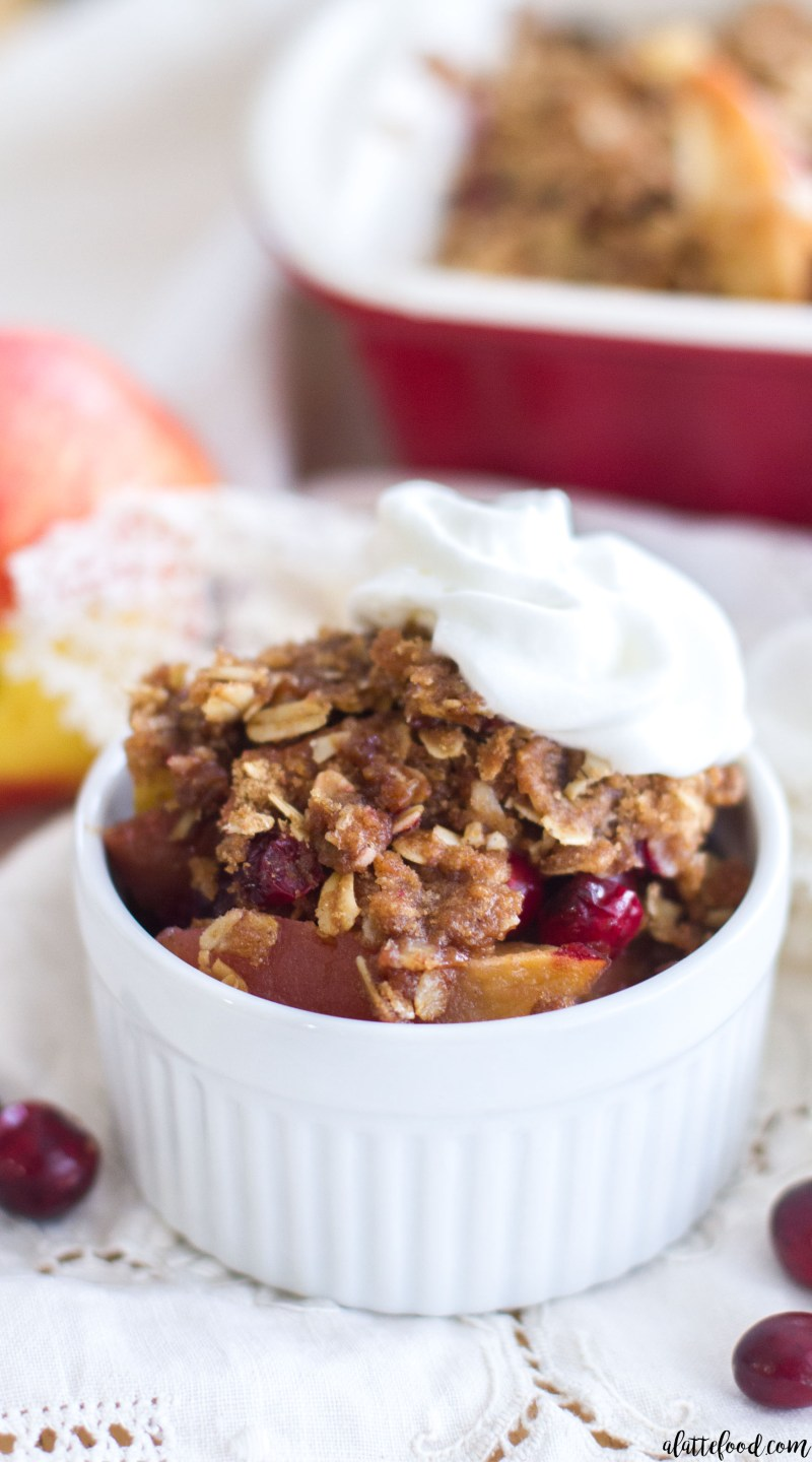 This easy fruit crisp recipe is filled with sweet apples and fresh cranberries, and is topped with the best brown sugar cinnamon crumble! A simple dessert perfect for the holiday season!