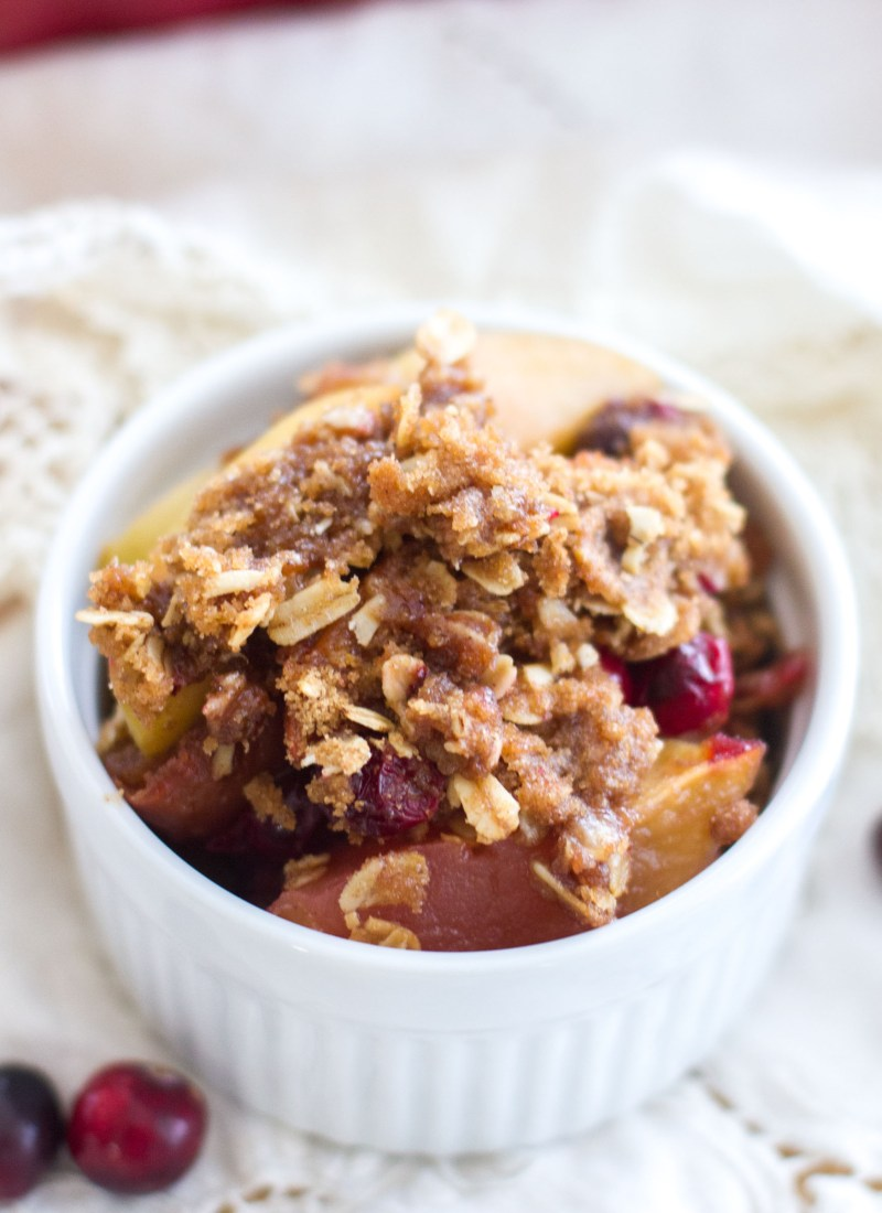 Easy fruit crisp recipe is filled with sweet apples and fresh cranberries, and is topped with the best brown sugar cinnamon crumble! A simple dessert perfect for the holiday season!
