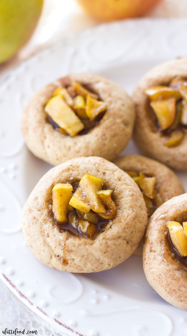 These easy apple pie thumbprint cookies are an amazing addition to your cookie recipe collection! Cinnamon vanilla dough is filled with sweet apple pie filling!