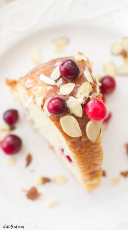 This easy cranberry almond bundt cake is made with fresh cranberries and topped with a white chocolate ganache! The sweet almond flavor pairs perfectly with the tart cranberry flavor. A fantastic Christmas dessert!