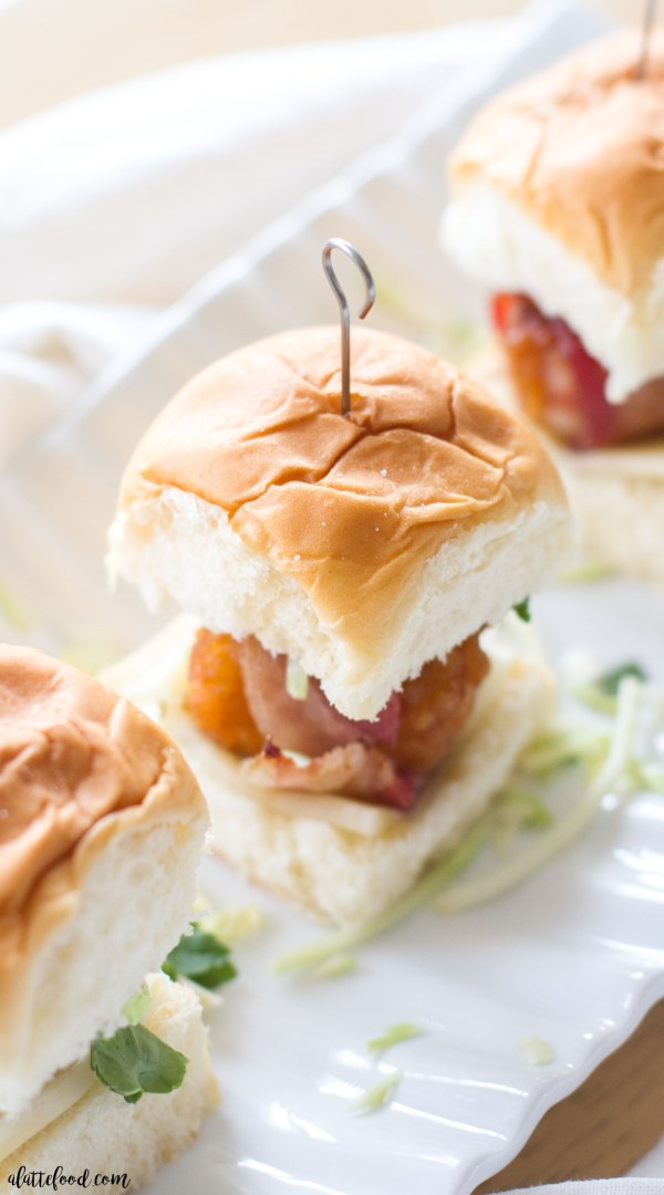 These easy bacon wrapped honey barbecue chicken sliders are the perfect game day appetizer! Made with boneless honey barbecue chicken and hickory smoked bacon, this simple chicken slider recipe tastes delicious and comes together quickly!