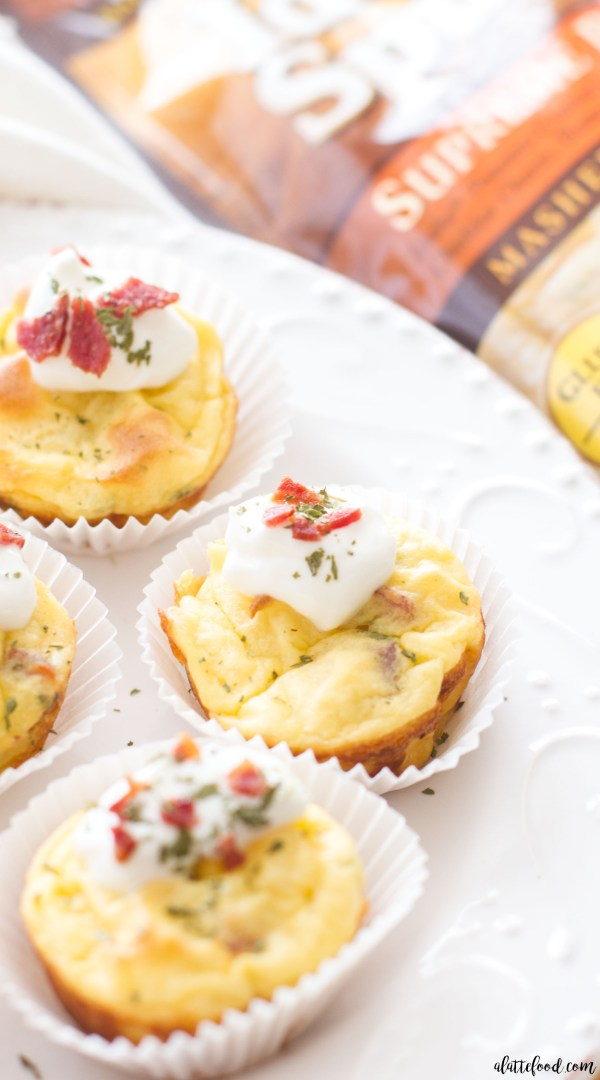 These easy bacon and chive mashed potato puffs are a perfect game day appetizer! This appetizer recipe starts with Idaho Spuds Supreme Baked Mashed Potatoes, and are filled with herbs, cheese, bacon, and sour cream to make a flavorful potato souffle.