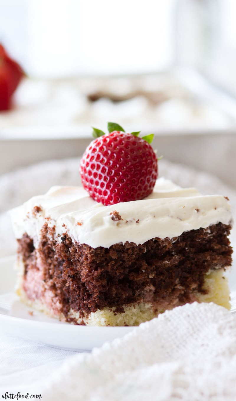 This homemade Neapolitan Sheet Cake recipe has swirls of vanilla cake, chocolate cake, and strawberry cake. This Neapolitan Cake is topped with the creamiest Whipped Cream Cheese Frosting, making this cake totally irresistible! chocolate cake, cake, desserts, strawberry cake