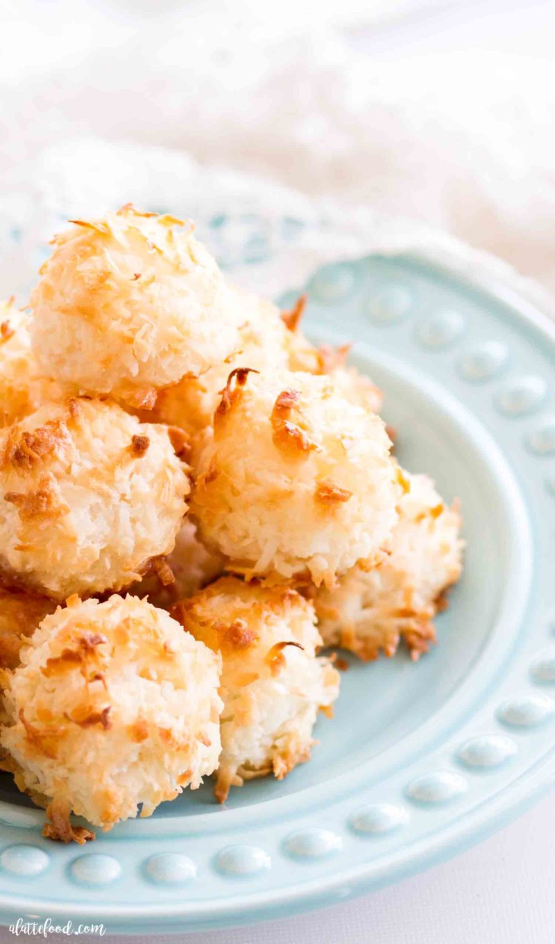 easy coconut macaroons stacked on a teal plate