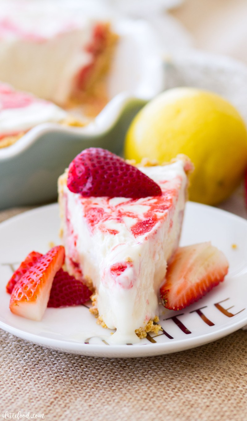Strawberry Lemonade Icebox Pie is pretty much summer in a pie dish! This easy strawberry icebox pie is a little tangy with the addition of lemonade concentrate, and super simple since it is a no-bake dessert! no bake, icebox pie, strawberry pie