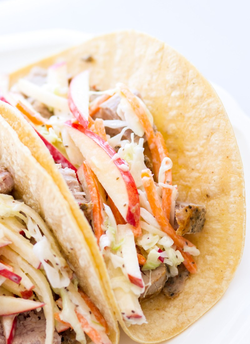 These easy Grilled Pork Tacos with Apple Slaw are made with Smithfield Marinated Fresh Pork and homemade apple slaw! This is a fantastic summer dinner, because it's quick and easy, and can be made in less than 30 minutes!