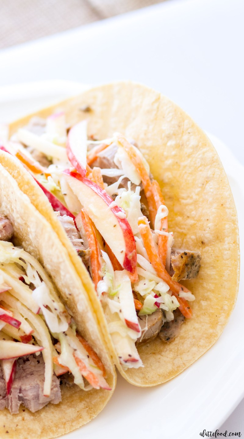 These easy Grilled Pork Tacos with Apple Slaw are made with Smithfield Marinated Fresh Pork and homemade apple slaw! This is a fantastic summer dinner, because it's quick and easy, and can be made in less than 30 minutes! apple coleslaw, carnitas, easy dinner recipes, pork tacos