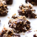 These homemade chocolate almond clusters are made with melted dark chocolate and toasted coconut to make an irresistible quick and easy snack or sweet treat! These Dark Chocolate Coconut Almond Clusters are super simple to make (as you can see in a step-by-step video below), and a total crowd pleaser!