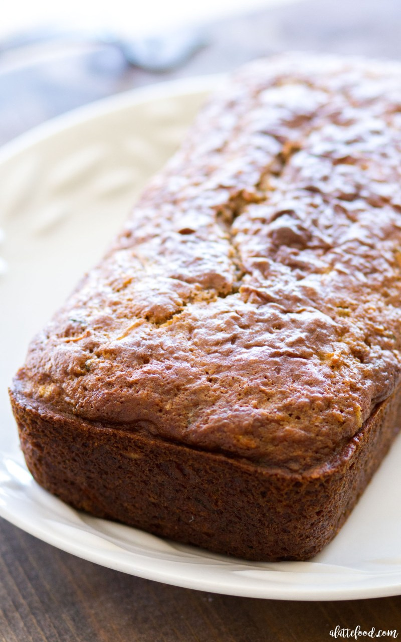 This homemade zucchini bread recipe is filled with shredded carrots, sweet pineapple, and coconut! Pineapple Carrot Zucchini Bread is spiced with ginger and cinnamon, and the perfect quick bread for breakfast, brunch, or an after school snack! Plus, a video below!